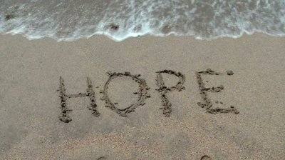stock-footage-the-water-wipes-off-the-word-hope-written-in-sand